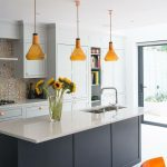 Kitchen, White Floor, White Cabinet, White Counter Top, Black Island, Yellow Pendants, Golden Backsplash