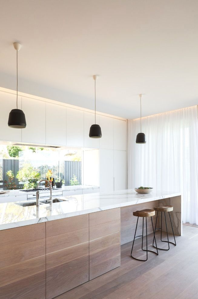 kitchen, wooden floor, white marble counter top, white cabinet, black pendants, wooden stools, glass windows