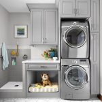 Laundry Room, Blue Carpeted Rug, Grey Cabinet With Vertically Stacked Laundry Machines, Grey Square Tiles