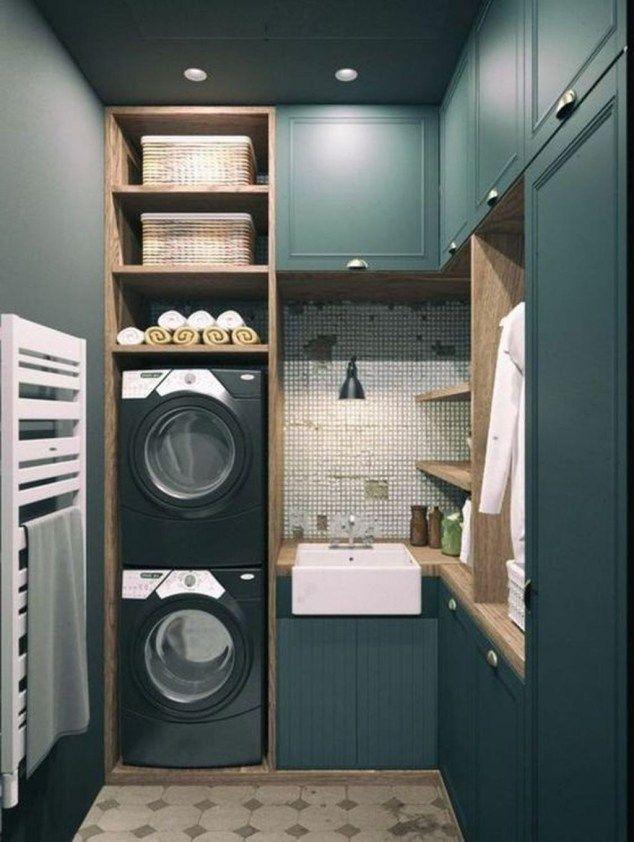 laundry room, dark green cabinet, stacked black machines, rattan basket, shelves, white sink