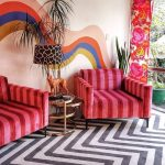 Living Room, Black And White Zigzag Rug, Painted Wall, Pink Striped Chairs, Round Side Table With Golden Frame