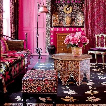 living room, black patterned rug, patterned coffee table, black flowery ottoman, patterned sofa, pink foor,