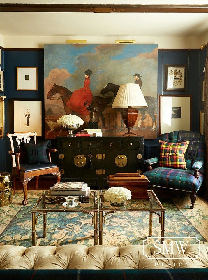 living room, flower patterned rug, green plaid chair, wooden chair, black wooden cabinet, glass coffee table