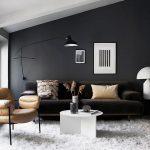 Living Room, Vaulted Ceiling, Black Wall, Black Sofa, Brown Chair, White Rug, Wooden Floor, Black Floor Lamp