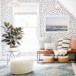 Living Room, White Ceiilng, White Wall With Black Polka Dots, Brown Leather Bench, White Pendant, Brown Floor, Blue Pendant Rug, White Leather Ottoman
