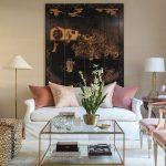 Living Room, White Floor, Cream Wall, White Floor, White Table Lamp, White Sofa, Animal Print Ottoman, Pink Chairs