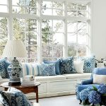 Living Room, White Rug, White Wooden Window Seat, White Cushion, White Blue Patterned Pillows, White Blue China Table Lamp, Blue Chair