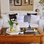 Living Room, White Rug, Wooden Coffee Table, White Sofa, White Pillows, White Wall, Table Lamp