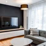 Living Room, Wooden Floor, Black Wall, White Floating Cabinet, Grey Corner Sofa, White Coffee Table, Floor Lamp