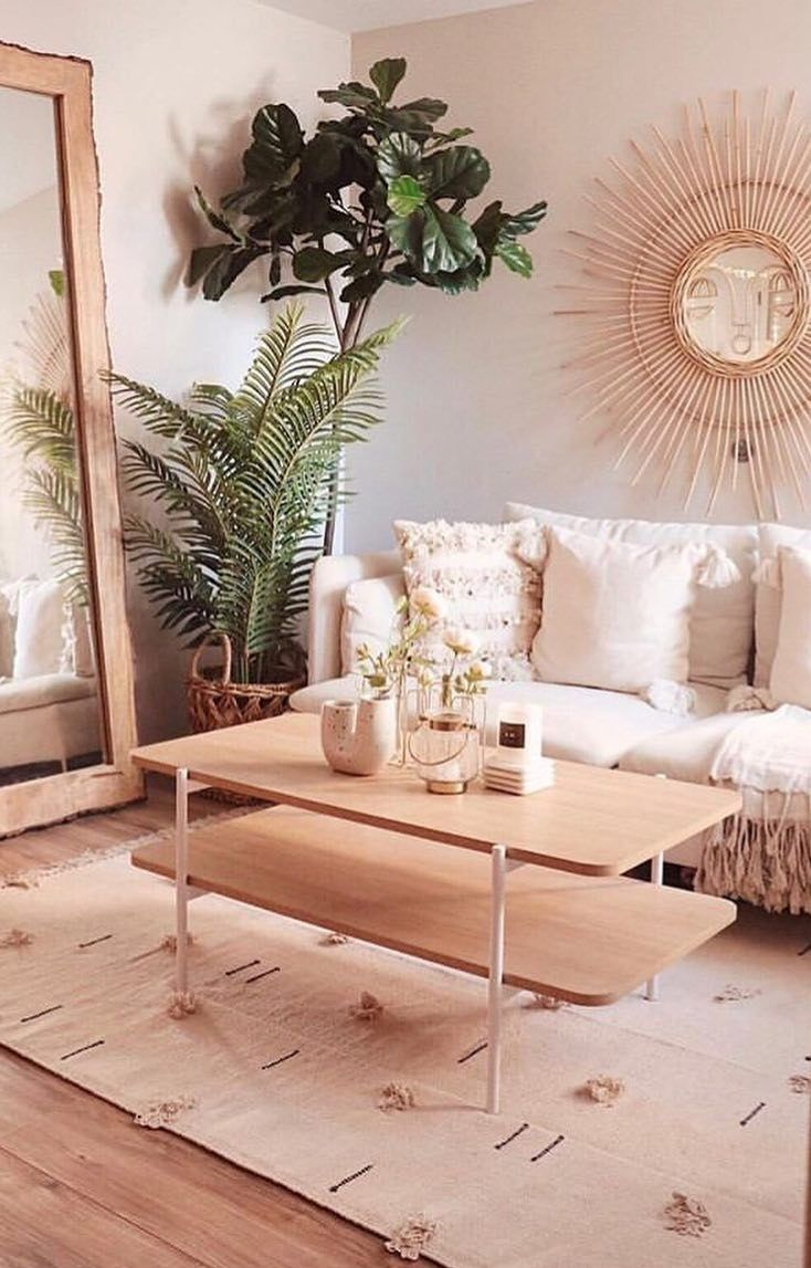 living room, wooden floor, brown rug, wooden coffee table, wooden framed mirror, white sofa