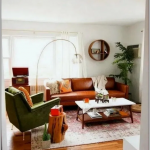 Living Room, Wooden Floor, White Wall, Red Rug, Brown Leather Sofa, Green Leather Chair, Wooden Coffee Table With White Top