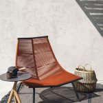Orange Woven Chair, Black Small Round Arble, Rug, Rattan Basket