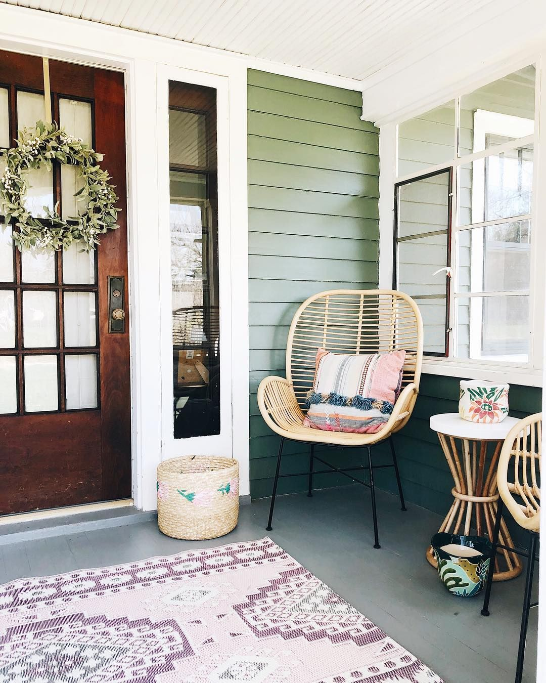 patio, wooden wall, concrete floor, patterned rug, white small round table