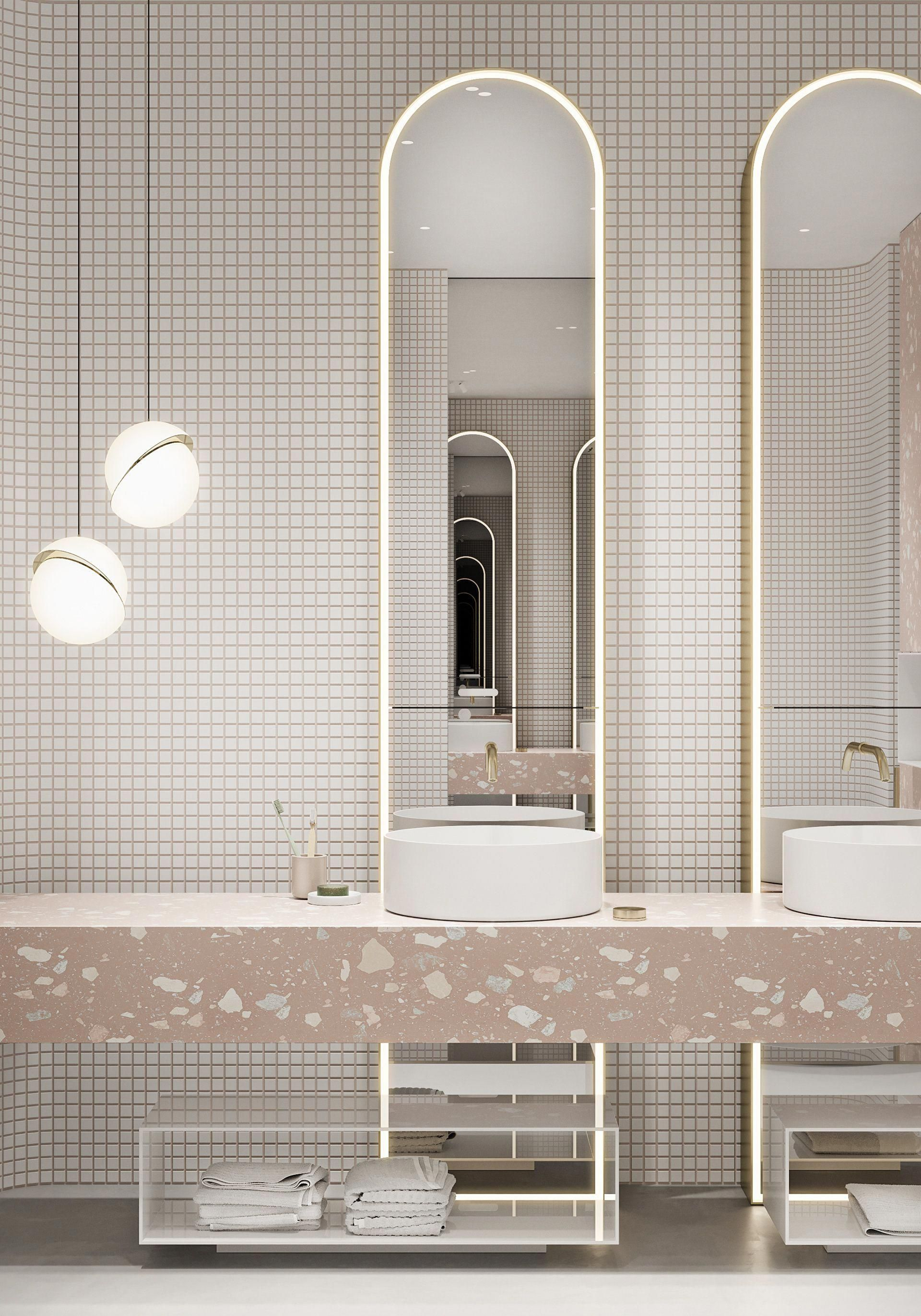 pink vanity, white round sinks, tall mirror, white tiny square wall tiles, white pendants