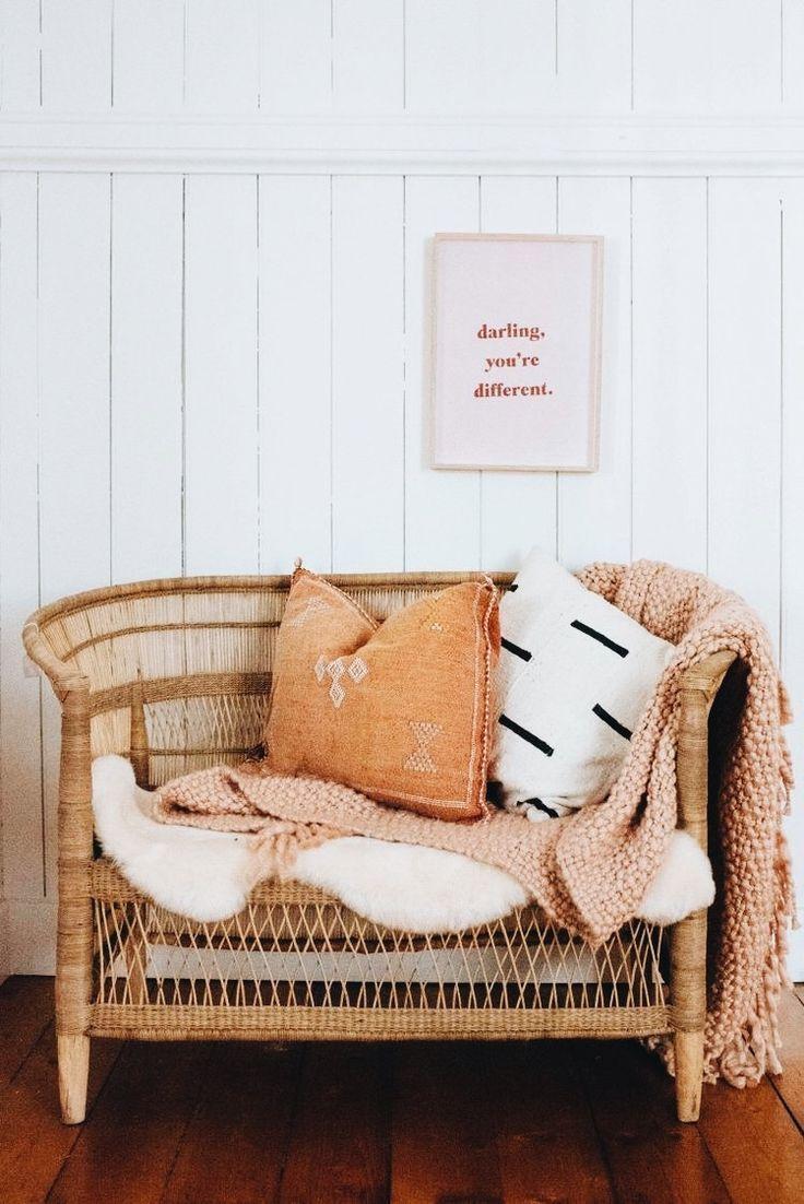 rattan sofa, white cushion, white wooden wall, wooden floor