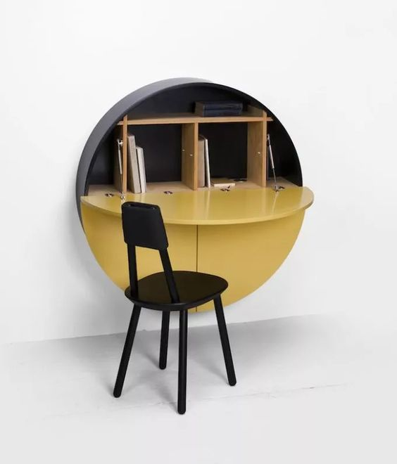 round cabinet in black and yellow with opened yellow door for table, black chair