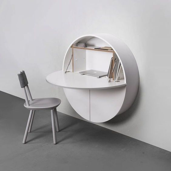 round floating cabinet in white, white chair,