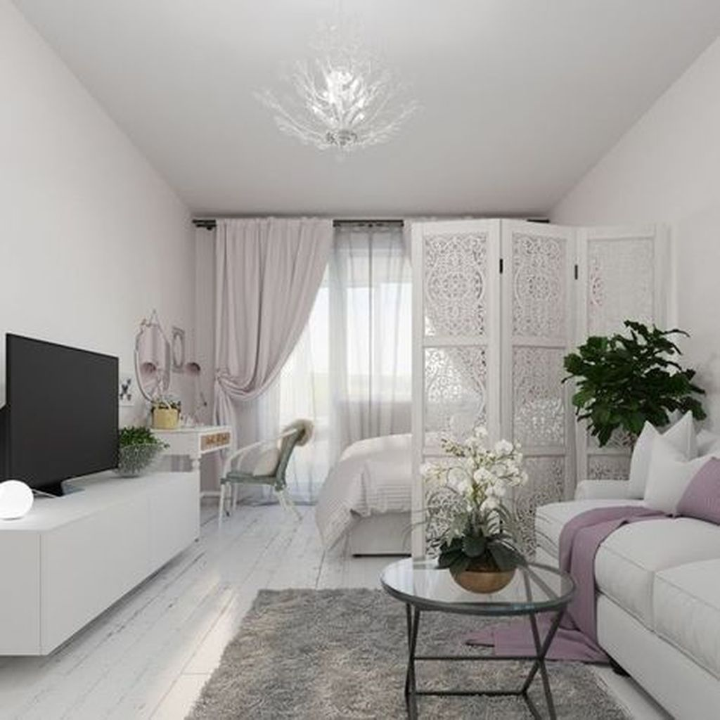 small apartment, white wall, white wooden floor, white cabinet, white bed, white sofa, round glass coffee table, white make up station