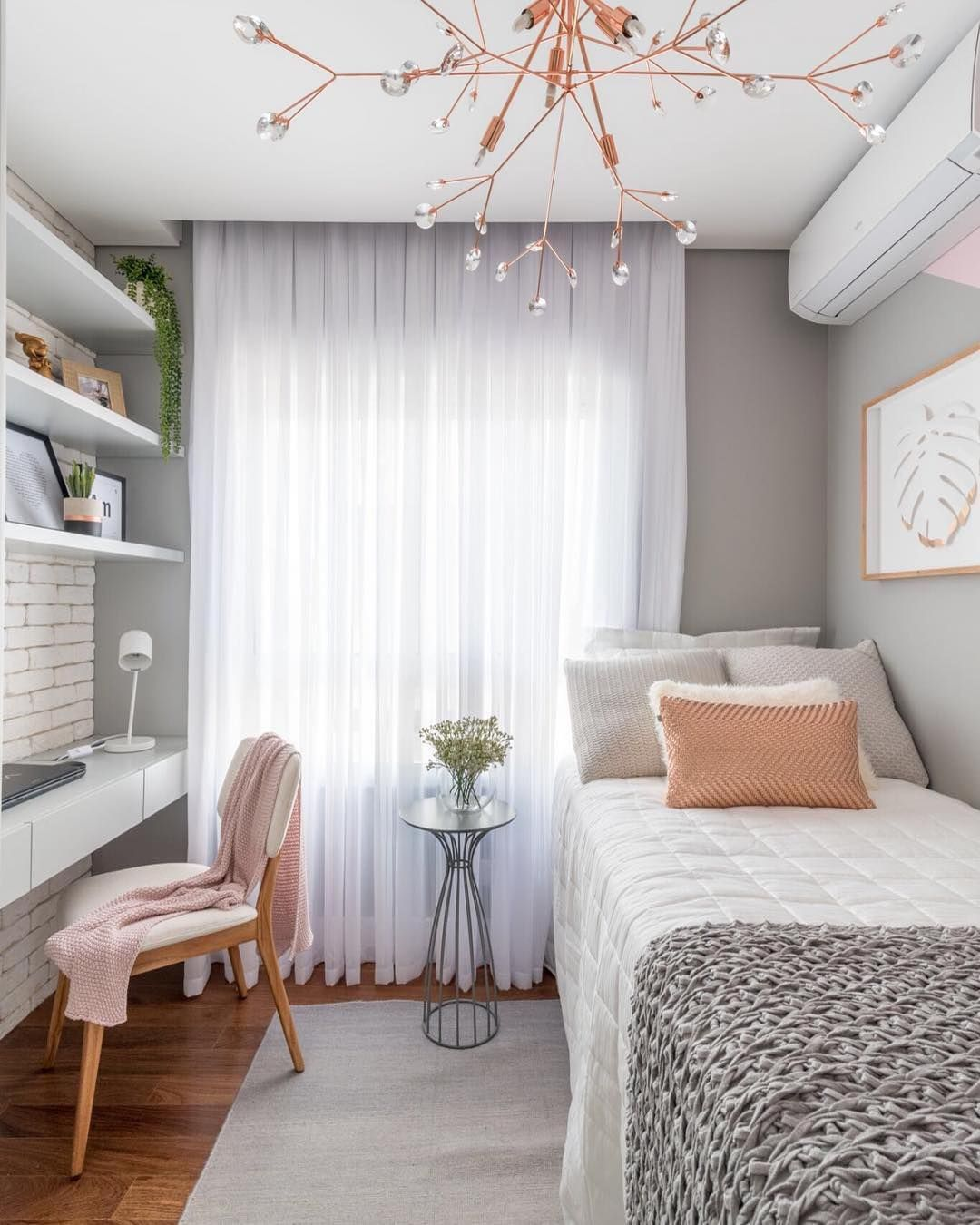 small bedroom, wooden floor, grey wall, white floating table with drawers, white floating shelves, grey wall, white exposed wall, side table, interesting lighting fixture