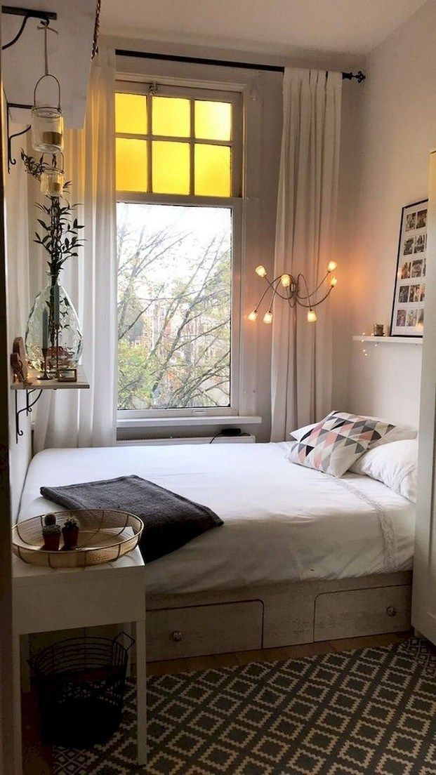 small bedroom, wooden floor, rug, white wall, white bed platform with drawers, window, white wooden side table