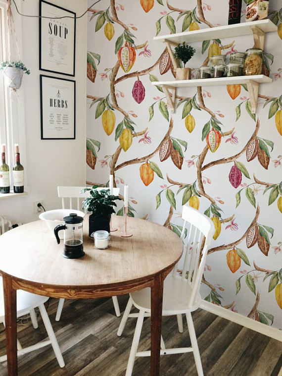 small dining set, white wooden chairs, round wooden table, white wall, fruity wallpaper, white floating shelves