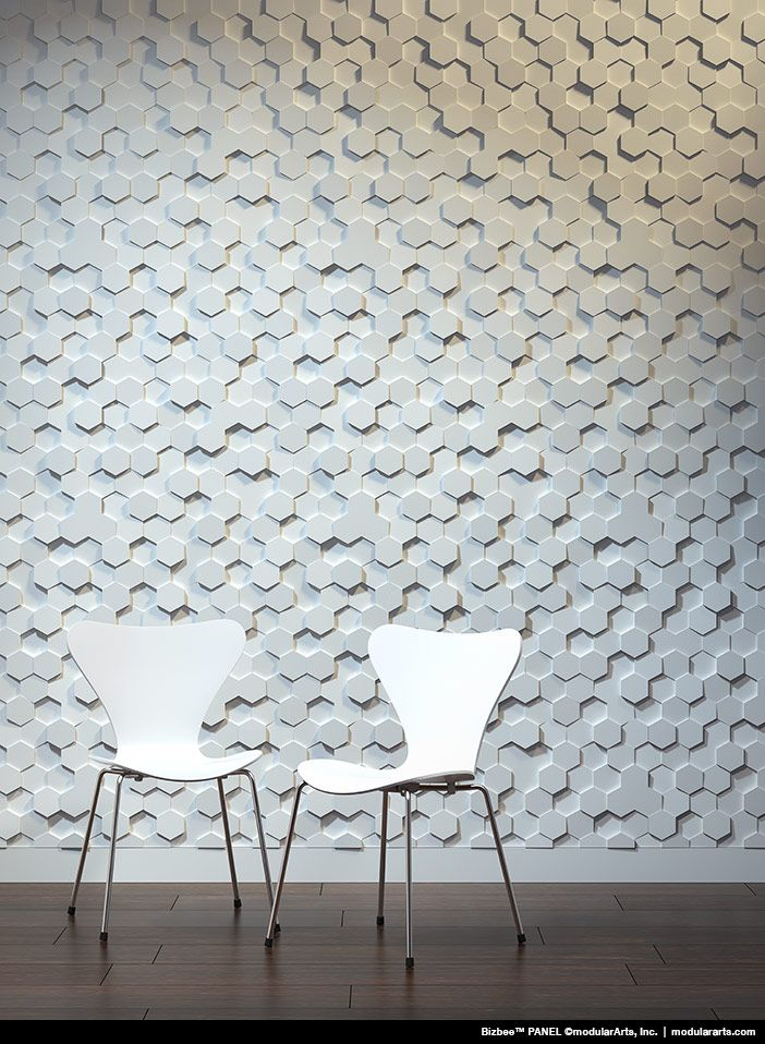 small hexagonal grey accent on the wall, white chairs