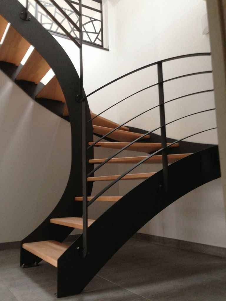 staircase, white wall, black fences, wooden stairs