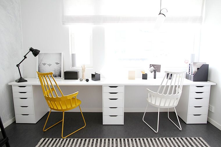 study room, black floor, white wall, white long table, white chair, yellow chair, black table lamp