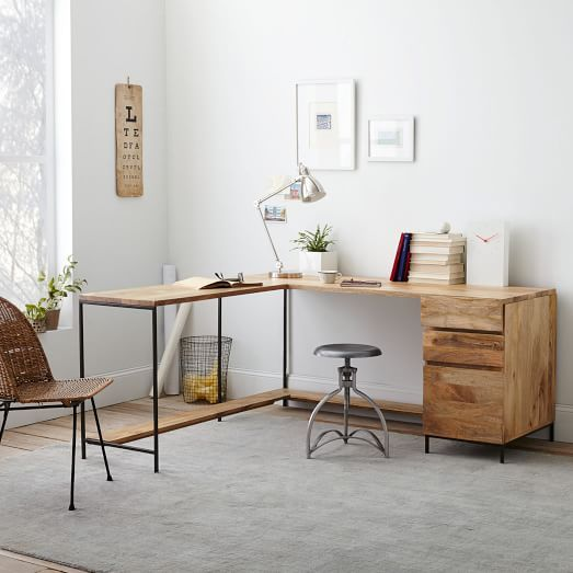 study room, grey floor, white wall, wooden table with drawers, silver table lamp, grey stool, rattan chair