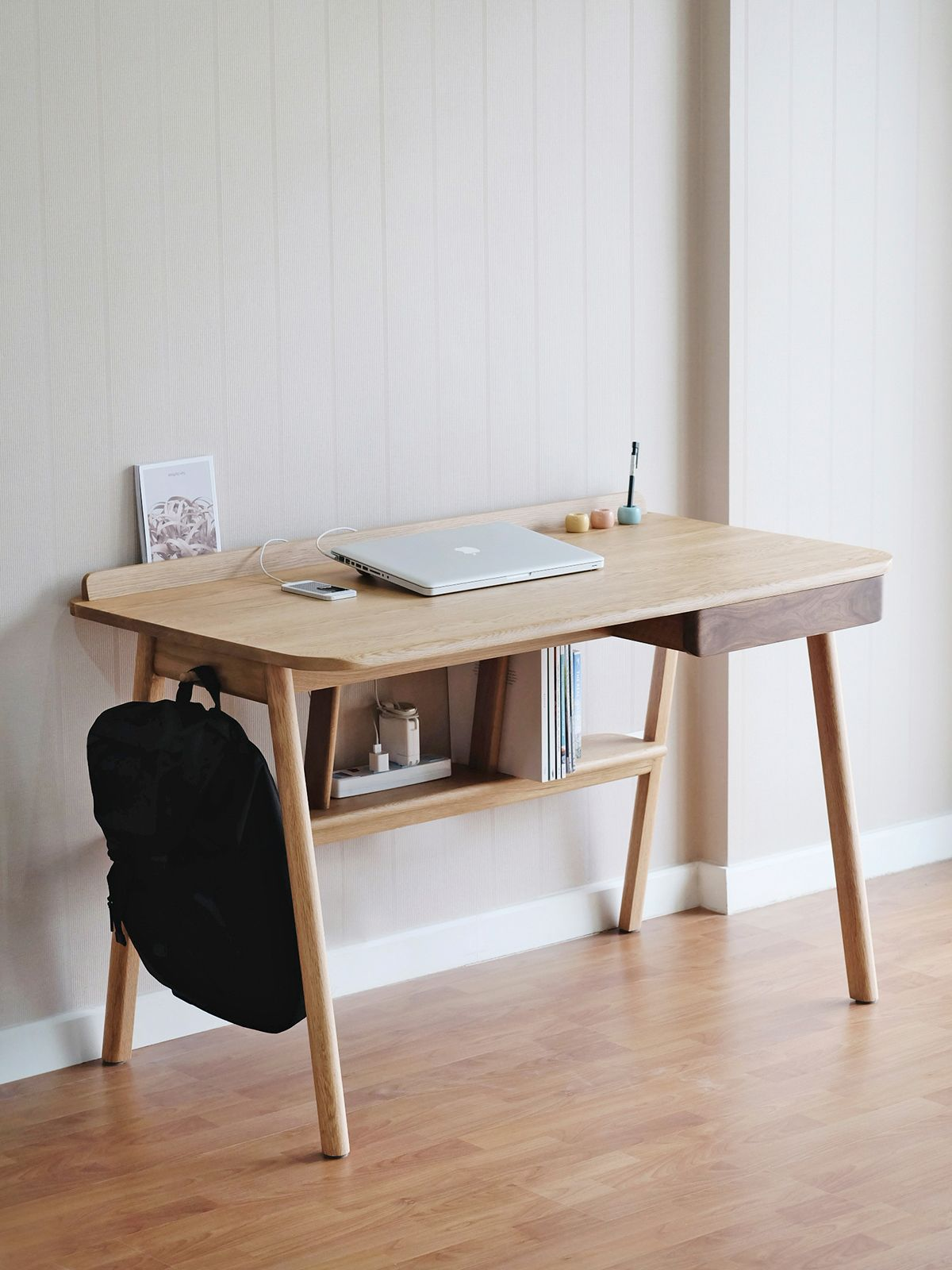 study room, wooden floor, cream wall, wooden table with shelves under the table