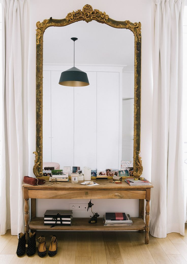 tal mirrors, on wooden table, golden frame, wooden floor