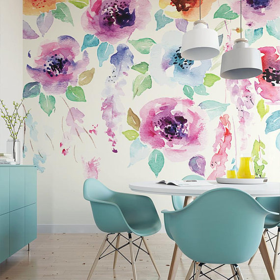 watercolor flower wallpaper, white pendants, white dining table, blue modern chairs, wooden floor