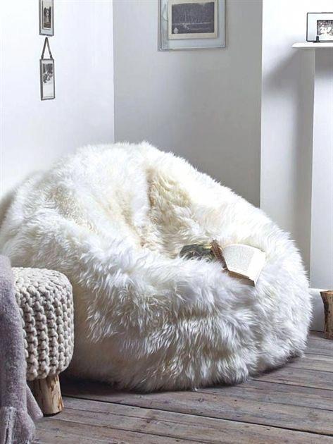 white fur bean bag, wooden floor, white wall, woven ottoman