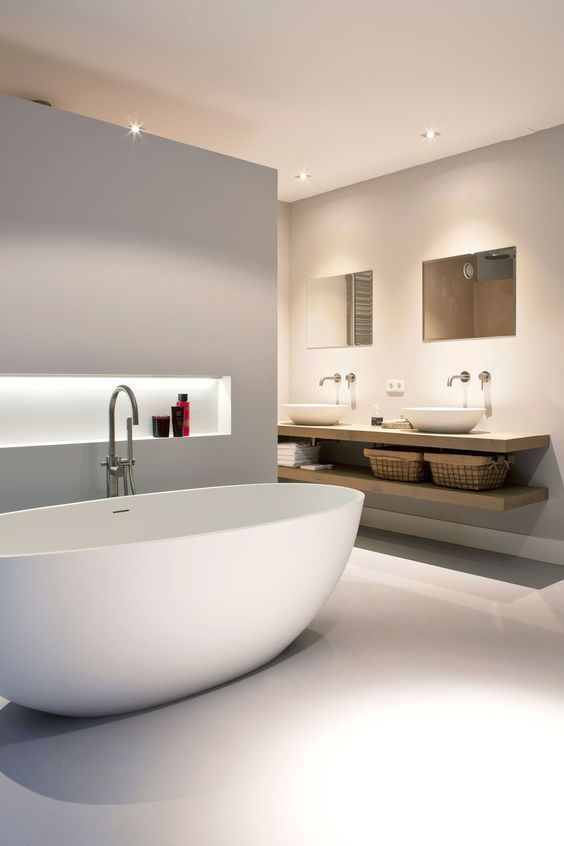 white seamless floor, white tub, indented, floating wooden vanity, white sinks, mirrors
