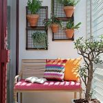 Wooden Bench, Wooden Floor, White Wall, Floating Pots Of Plants, Pink Cushion