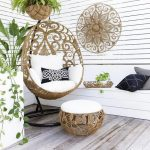 Wooden Floor, White Wooden Wall, Rattan Swing Chair With White Cushion, Rattan Ottoman White Cushion