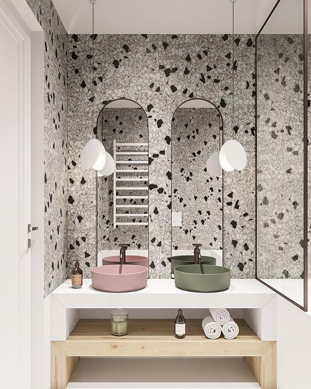 wooden vanity in natural brown and white, pink round sink, green round sink, marble wall, white pendants, tall mirror
