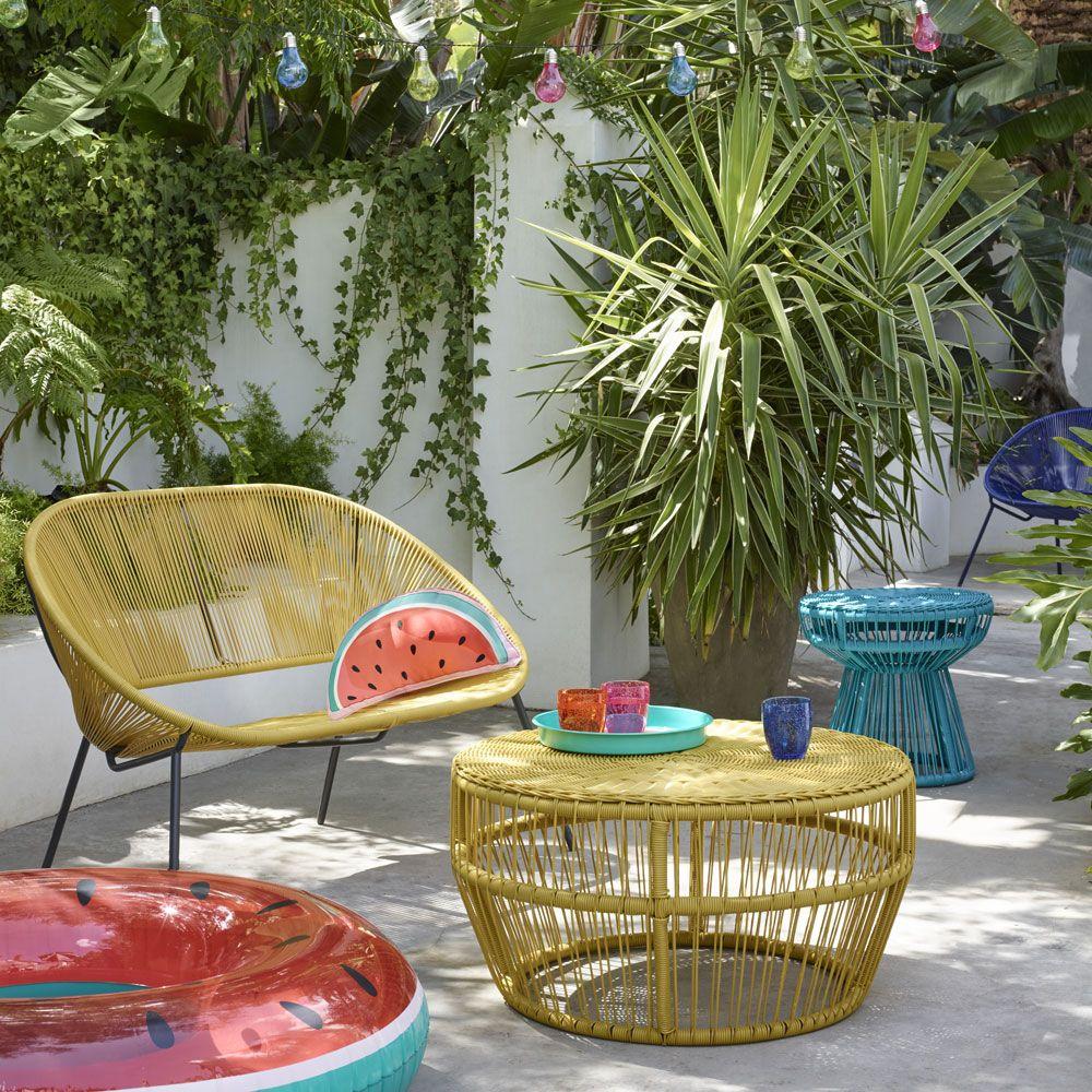 yellow rattan sofa, yellow rattan woven coffee table, blue rattan stool, grey floor, plants