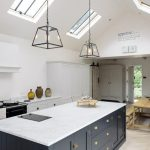 Accent Ceiling, Vaulted Ceiling, Ceiling Window, Black Iron Pendant, White Wall, White Kitchen Cabinet, Black Island With White Top