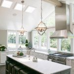 Accent Ceiling, White Wooden Vaulted Ceiling, Ceiling Windows, Iron Pendants, White Kitchen Cabinet, Dark Grey Island With White Top