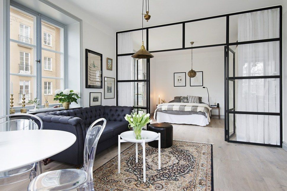 apartment, white floor, white wall, black tufted sofa, whie round tulip table, whiet tray coffee table, white bed, glass partition