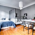 Apartment, Wooden Floor, Grey Wall, Blue Bedding, Glass Partition, White Sofa, Patterned Rug, White Dining Table, White Balck Chairs, White Pendant