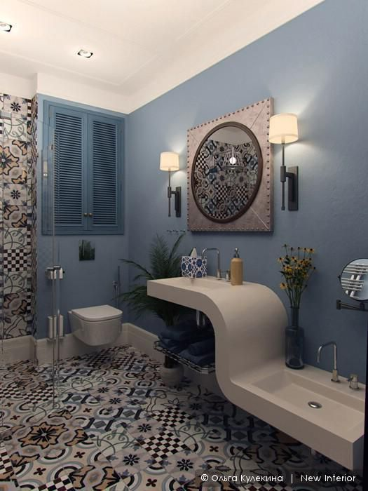 bathroom, blue wall, patterned floor, patterned accent wall, white sconces, white curvy sink, white toilet