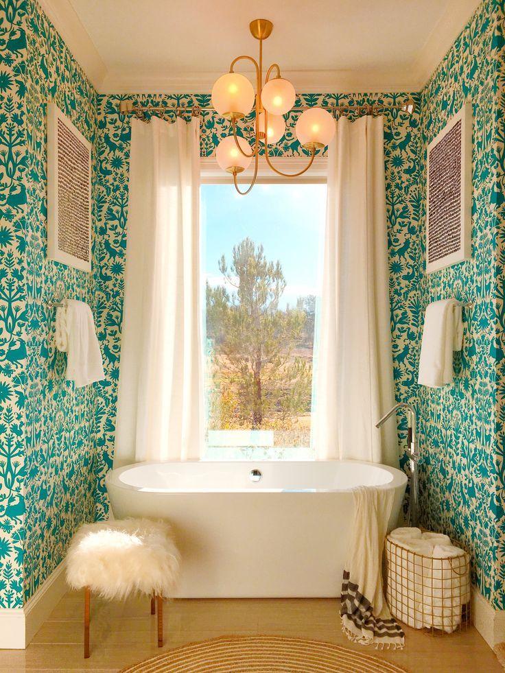 bathroom, brown floor tiles, green wallpaper, modern chandelier, white tub, white stool, white curtain