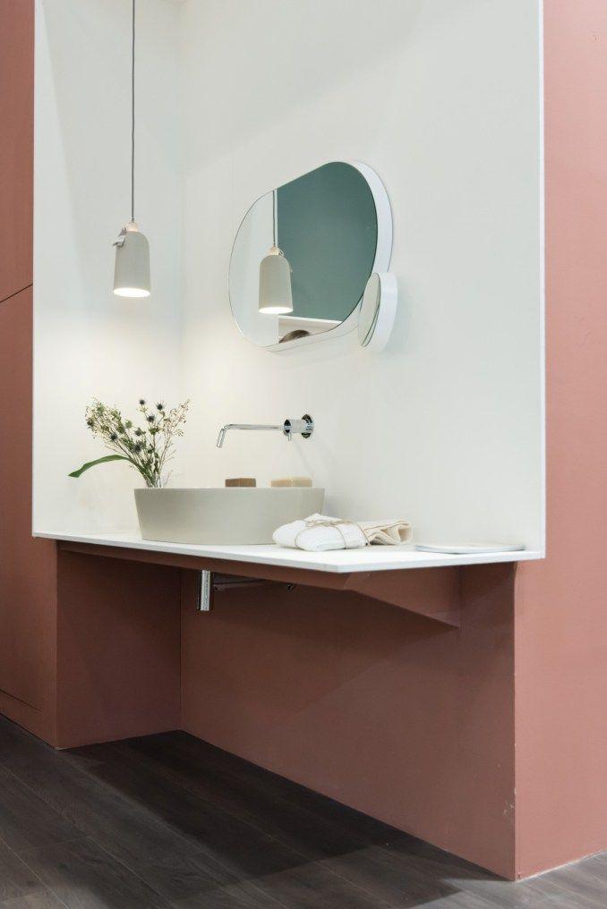 bathroom, grey floor tiles, pink wall, white box vanity, oval mirror, white pendant, white sink