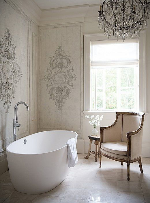 bathroom, white floor, white carved wall, chandelier, classy white chair