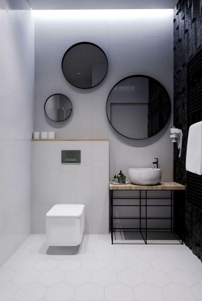 bathroom, white hexagonal floor tiles, black wall, white wall, whtie toilet, round mirror, vanity table, white round sink