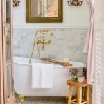 Bathroom, White Marbled Floor, White Tub With Golden Claw Feet, Wooden Stools, Golden Mirror, Wooden Cabinet