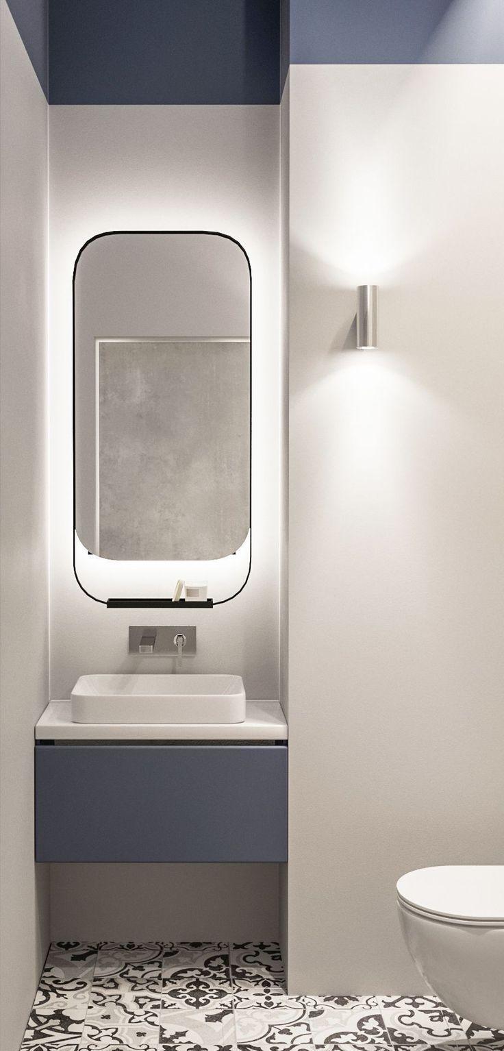 bathroom, whtie wall, patterned floor, white toilet, blue floating vanity, white sink