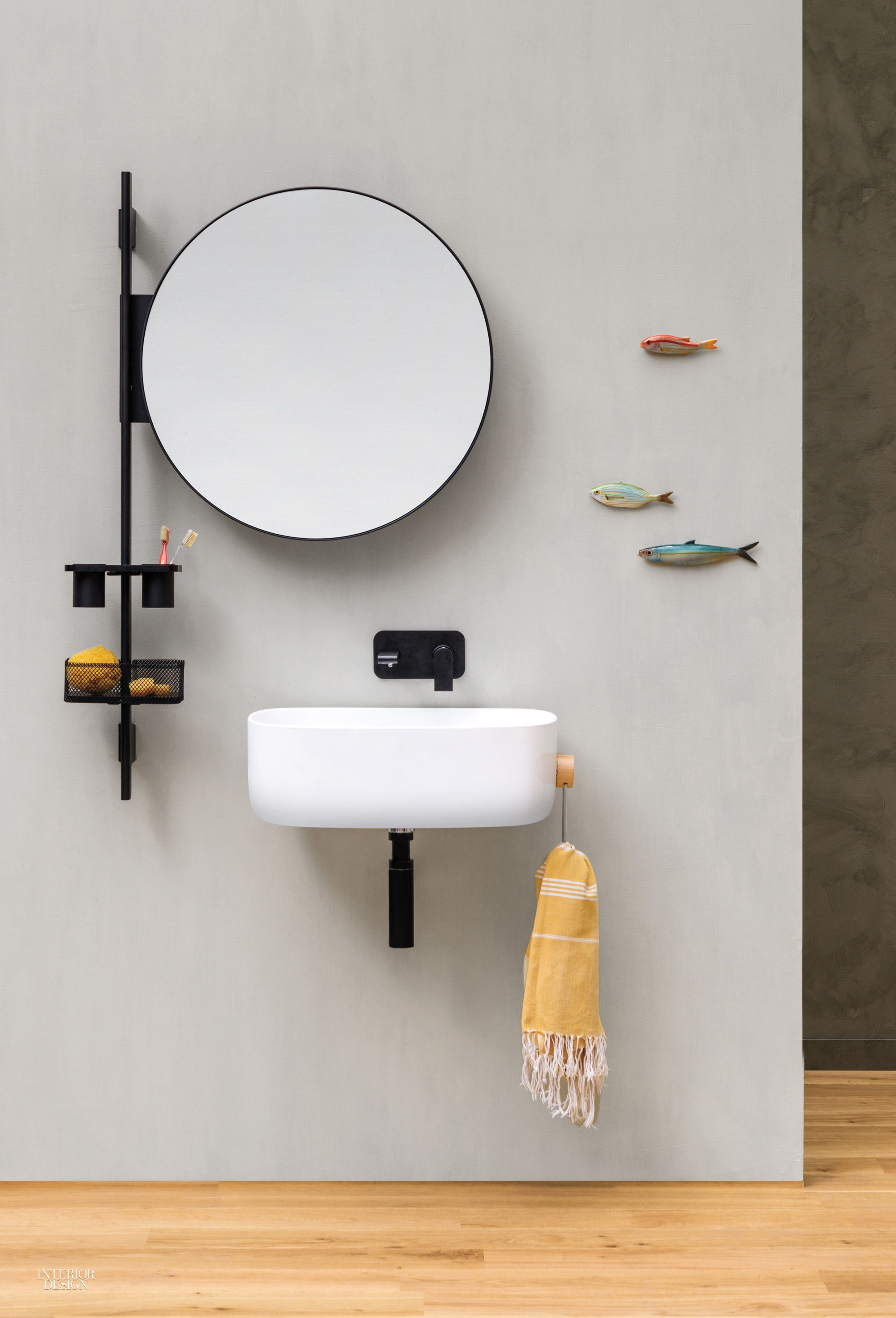 bathroom, wooden floor, white wall, round mirror, small floating sink